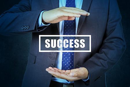 手握成功商务人士图片
