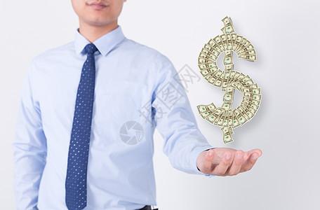 手持钱币的男人图片