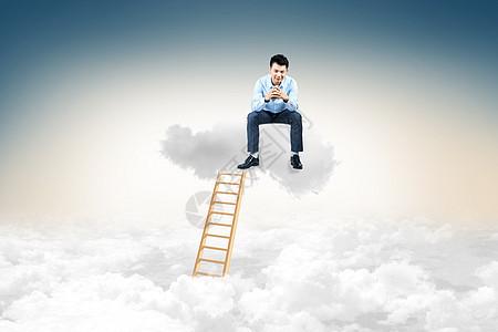 登梯上云层商务男士图片