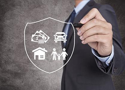 绘制屏蔽保护家庭、 房子、 车子、 金钱的商人图片