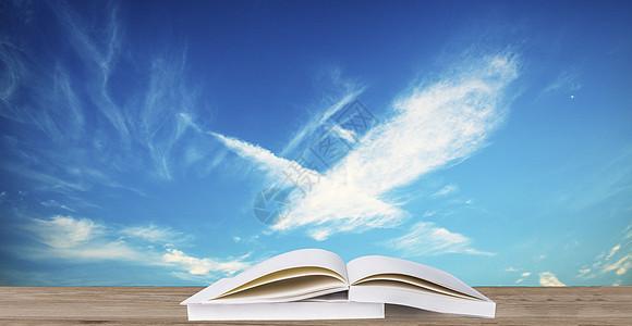 蓝天白云下的书图片