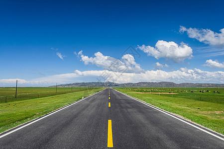 草原公路路面背景素材图片