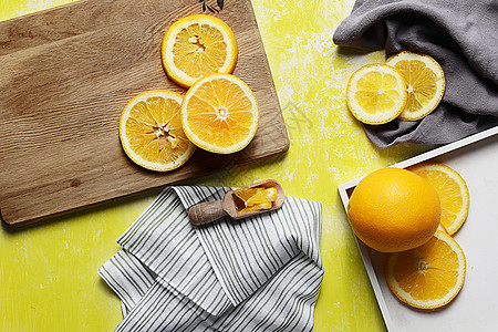 夏日橙子布景黄色背景素材图片