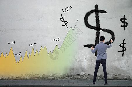 商务人在墙上画美元图片