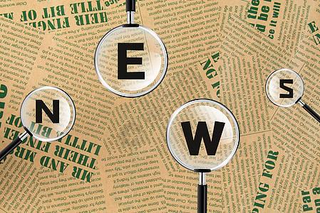 在报纸上用放大镜看新闻图片