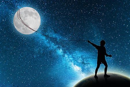 捕捉月亮小孩图片