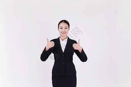 竖起大拇指点赞的职业女性客服形象图片