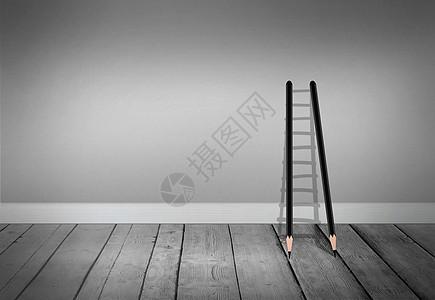 灰色空间的铅笔梯子图片