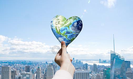 指间的爱心地球图片