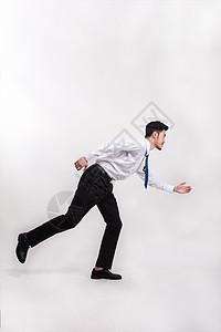 穿着西装跑步的白领上班族图片