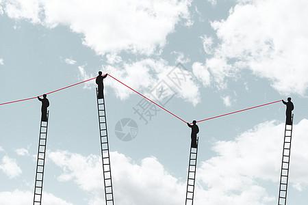 商务人士站在梯子上拉曲线图片