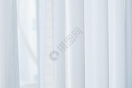 自然下垂的白色窗帘图片