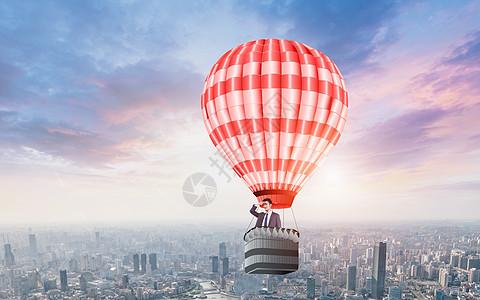 承载热气球上升瞭望城市商务男士图片