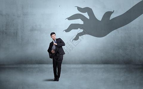 伸出魔爪夺取他人财产背景图图片