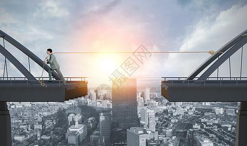 拉着桥的商务人士图片