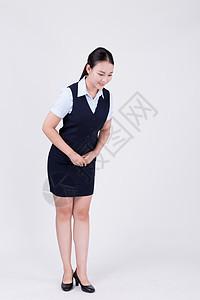 商业美女客服弯腰鞠躬图片