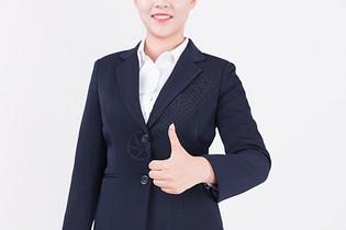 竖起大拇指点赞的职业女性形象图片