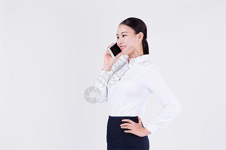 使用手机的办公室职业女性图片