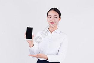 客服销售职员展示手机动作图片