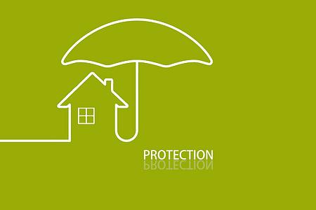 创意雨伞房屋绿色背景图片