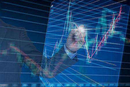 商务男士与股票证券信息走势图图片