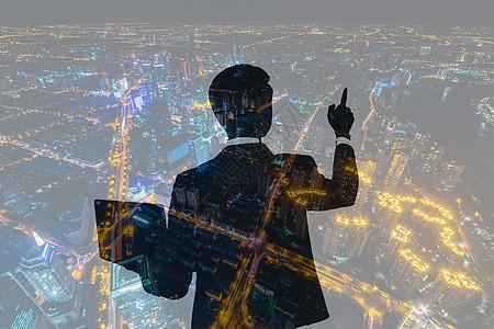 商务男士触点城市风光夜景图片