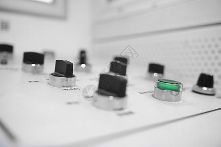 绿色圆形电器按钮图片