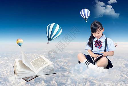 坐在云上看书的小女孩背景图片
