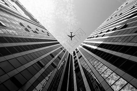 黑白商业飞机与建筑图片