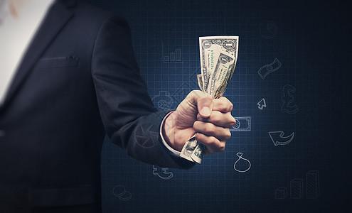商务人士手握金钱图片