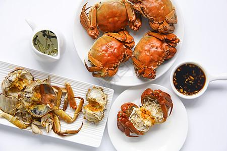 吃大闸蟹蟹黄白底背景素材图片