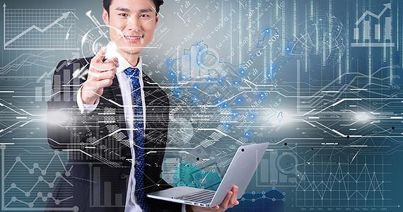 商务西装男士拿着电脑庆祝成功图片