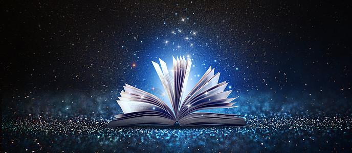 黑夜中绽放光芒的书图片