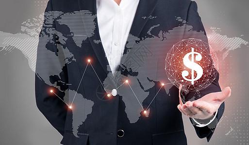 商人手在屏幕显示虚拟图形与美元的商业概念图片