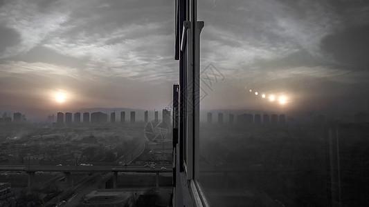 城市雾霾落日夕阳建筑天际线图片