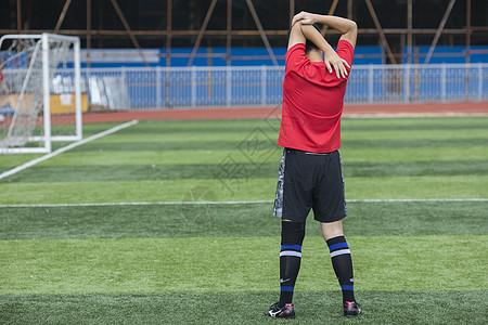足球运动员在做热身运动图片