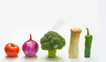 竖起来整齐摆放的蔬菜图片