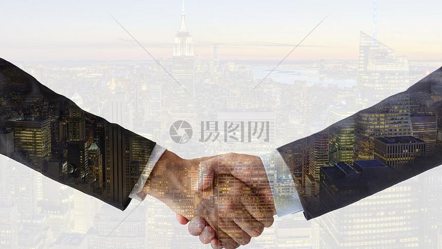 商务人士握手合作图片