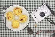 相机和蛋挞图片