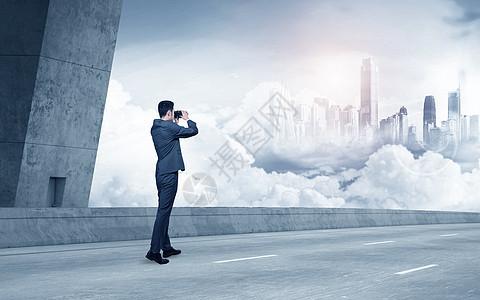 站在桥上观看云层商务男士背景图图片