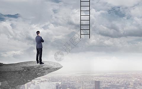 站在悬崖边瞭望成功梯子商务男士背影图片图片