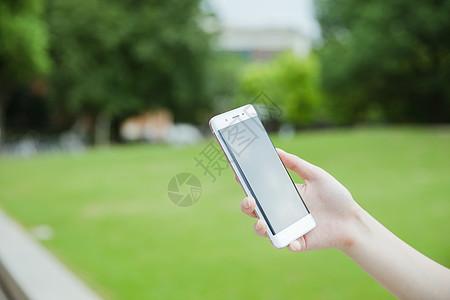 手握手机素材图片
