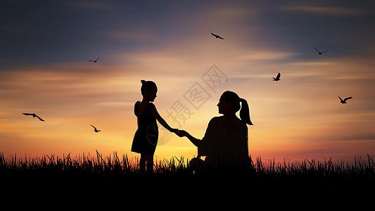 夕阳下交谈的母女图片