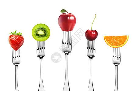 叉子上的水果图片