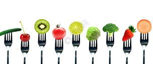 叉子与水果蔬菜图片