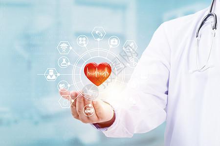医生手持红心形状与医学虚拟屏幕界面图片
