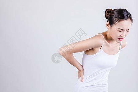 居家女人表现腰疼情绪图片