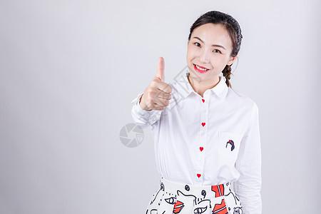商务女士开心举大拇指图片