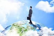 站在地球上的商人图片