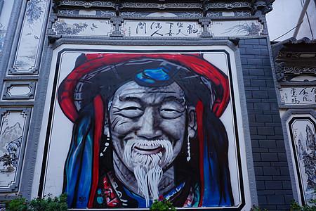 云南丽江古城艺术墙绘图片